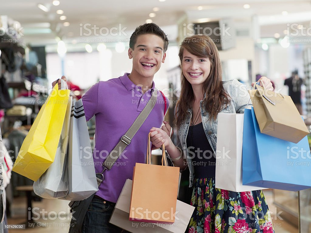Smiling couple carrying shopping bags in store royalty-free stock photo