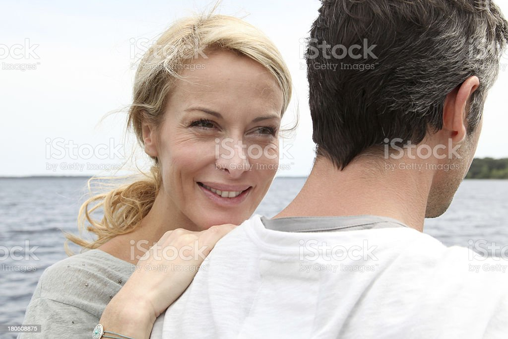 Smiling couple discovering lake during holidays royalty-free stock photo