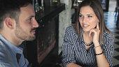 Smiling couple enjoying in the bar