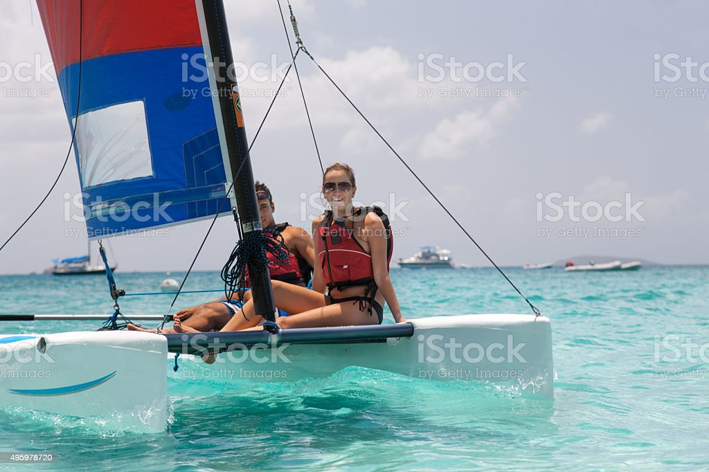 smiling couple enjoying sailing on a catamaran in St.John, USVI stock photo