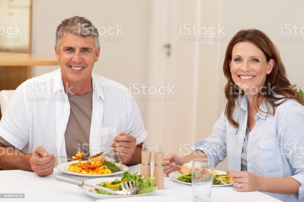 Smiling couple having dinner stock photo