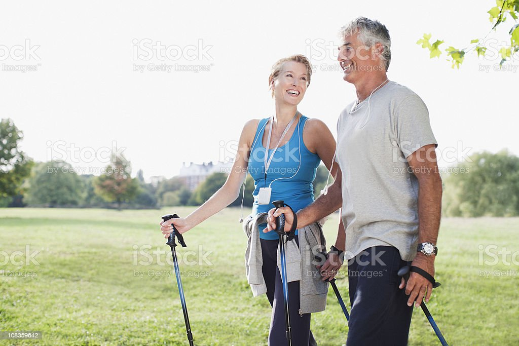 Smiling couple hiking together stock photo