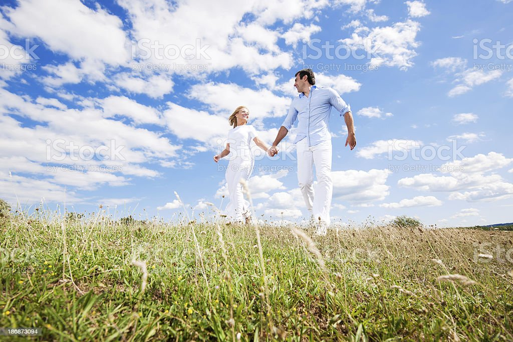 Smiling couple holding hands in nature. royalty-free stock photo