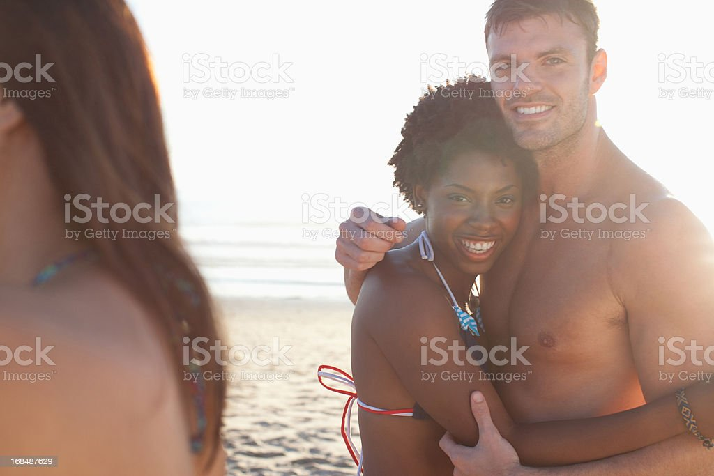 Smiling couple hugging on beach royalty-free stock photo