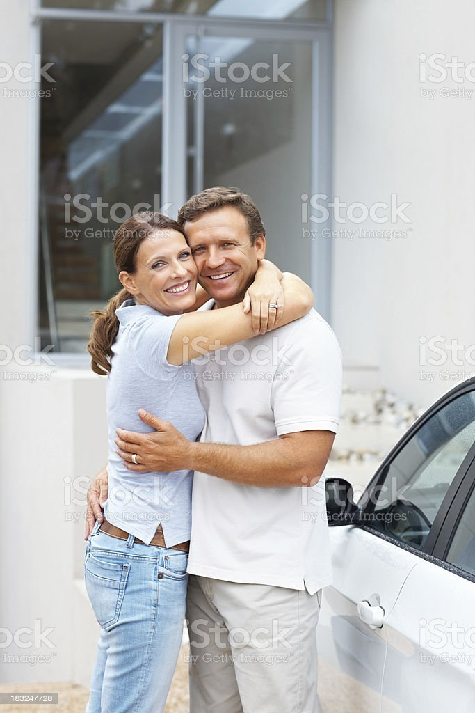 Smiling couple hugging royalty-free stock photo