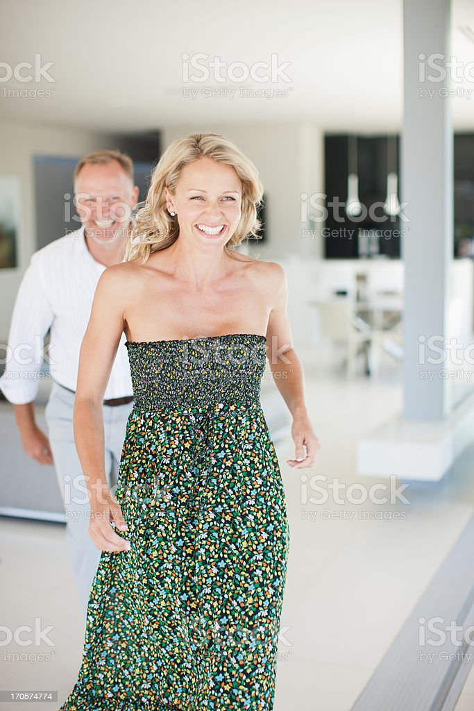 smiling couple in living room stock photo
