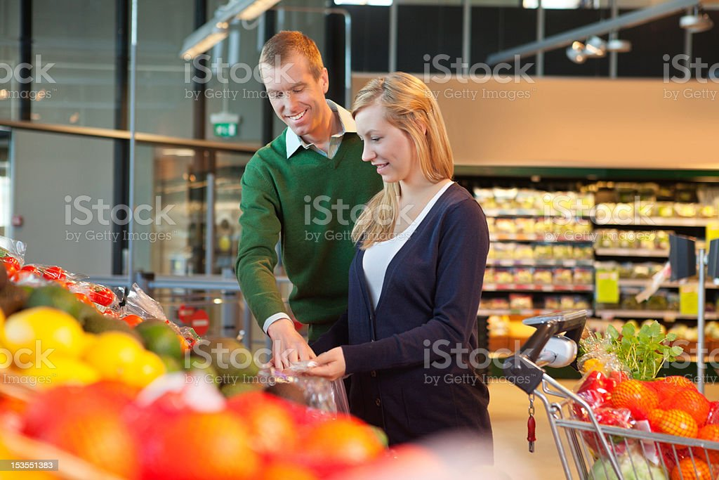 Smiling couple in shopping store royalty-free stock photo