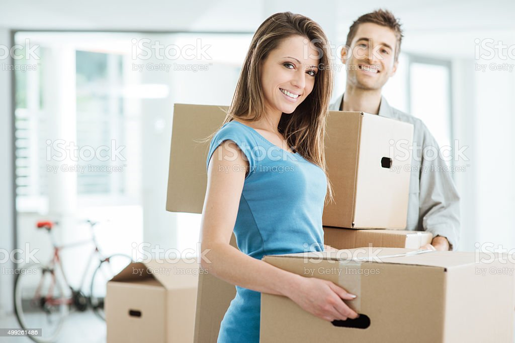 Smiling couple moving in a new house stock photo