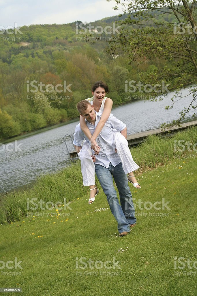smiling couple on a meadow royalty-free stock photo