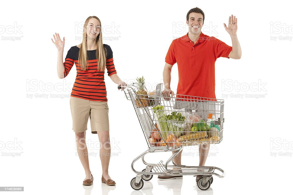 Smiling couple standing in a supermarket royalty-free stock photo