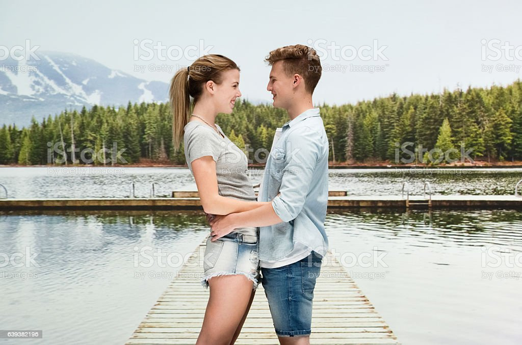 Smiling couple standing outdoors stock photo