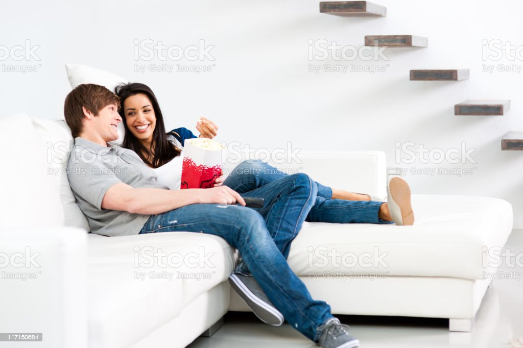 Smiling couple watching TV royalty-free stock photo