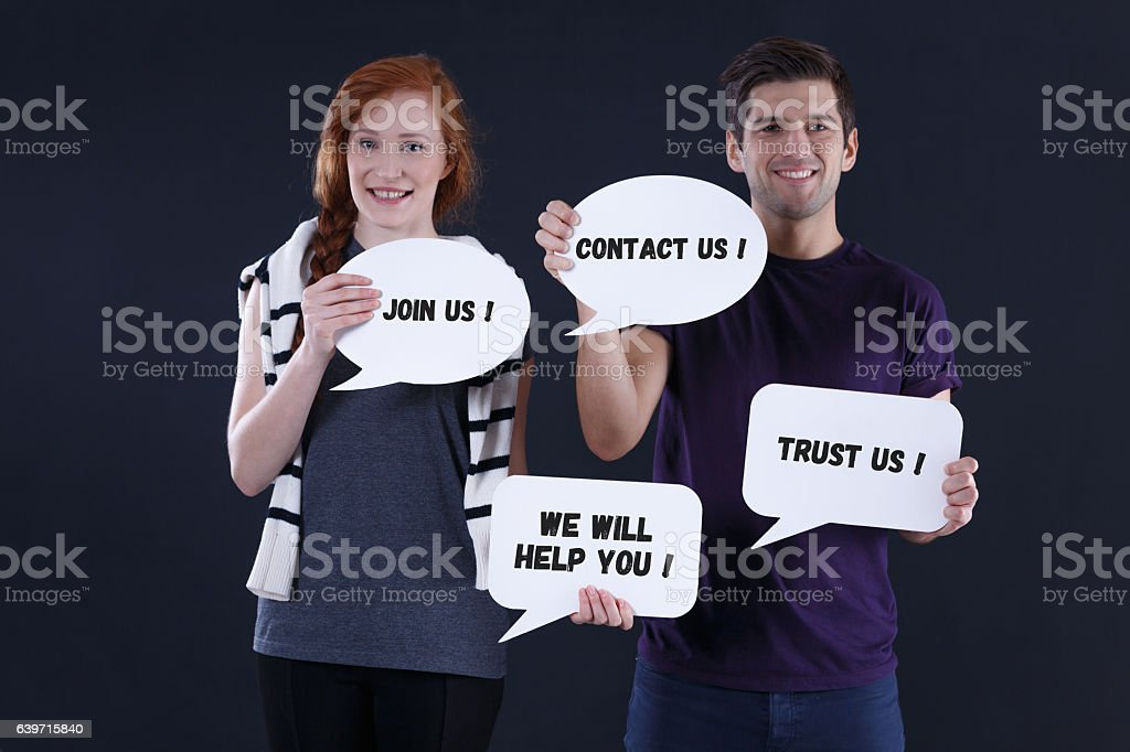 Smiling couple with speech bubbles stock photo