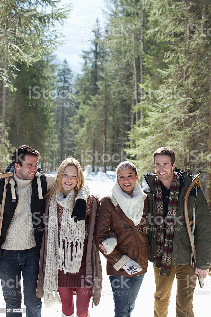 Smiling couples walking in woods royalty-free stock photo