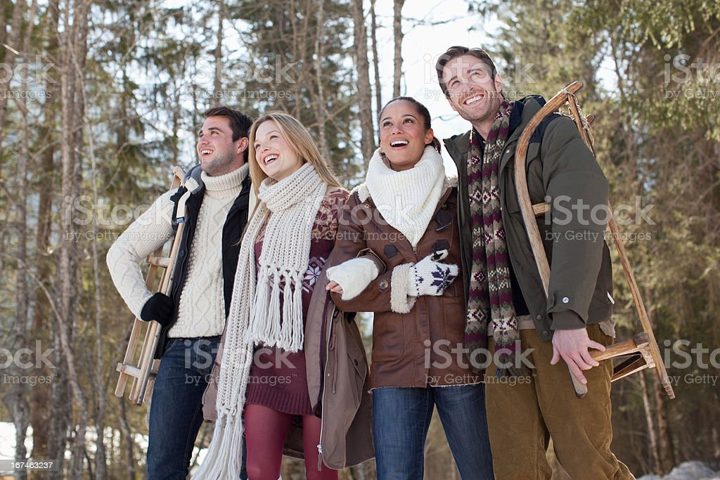 Smiling couples walking in woods stock photo
