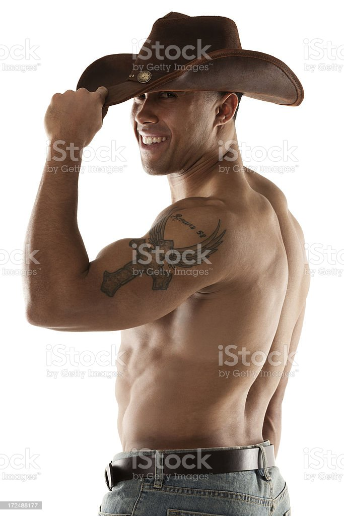 Smiling cowboy with tattoo on his arm royalty-free stock photo