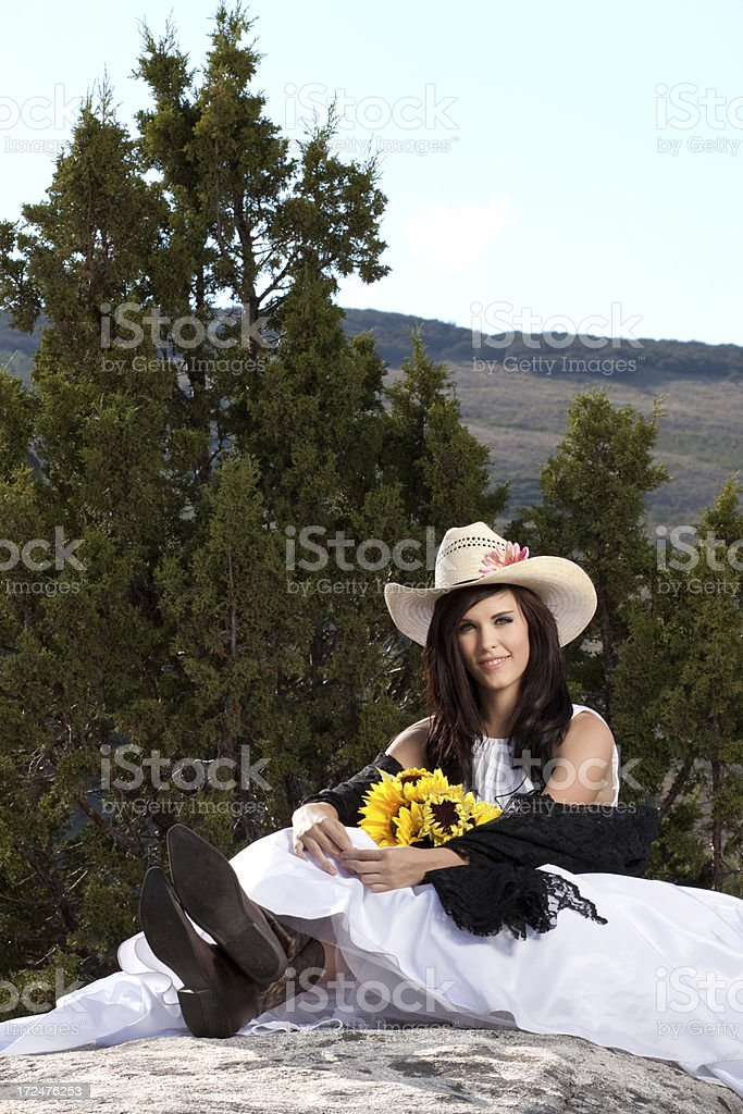 Smiling Cowgirl Bride in the Mountains royalty-free stock photo