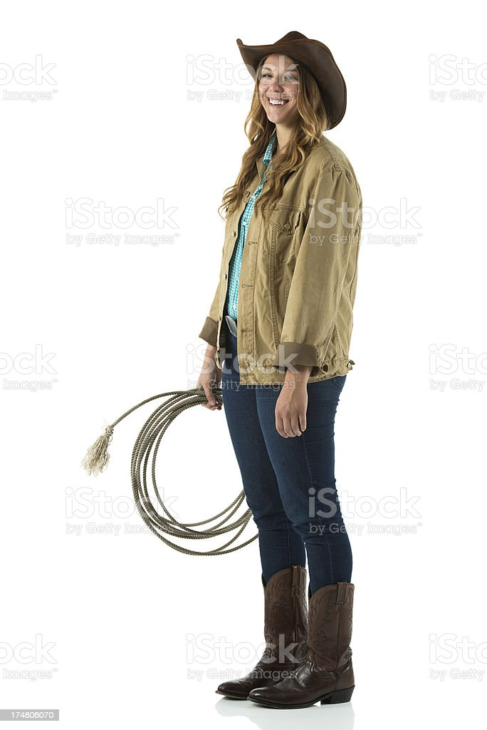 Smiling cowgirl holding a lasso royalty-free stock photo