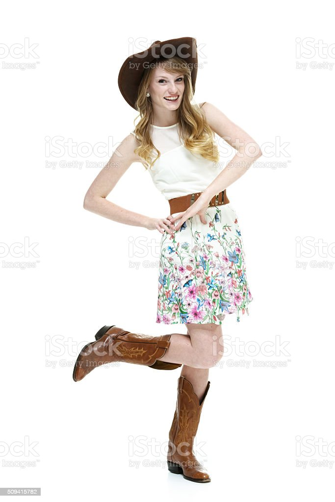 Smiling cowgirl looking at camera stock photo