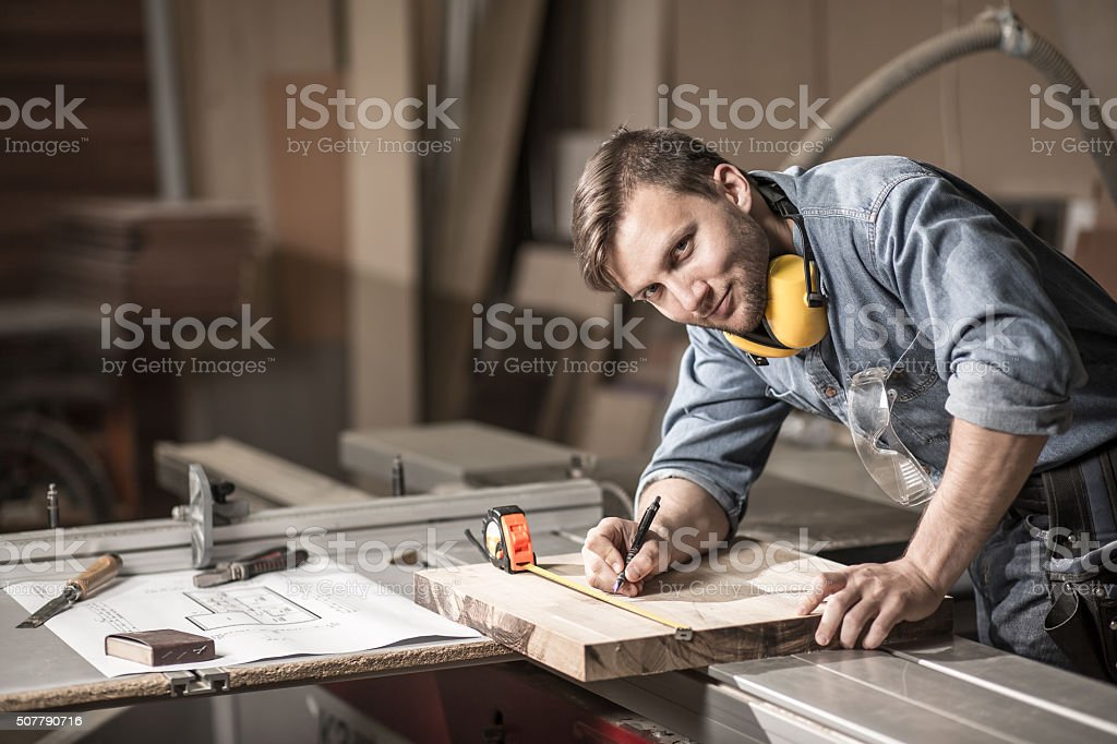 Smiling craftsman during his work stock photo