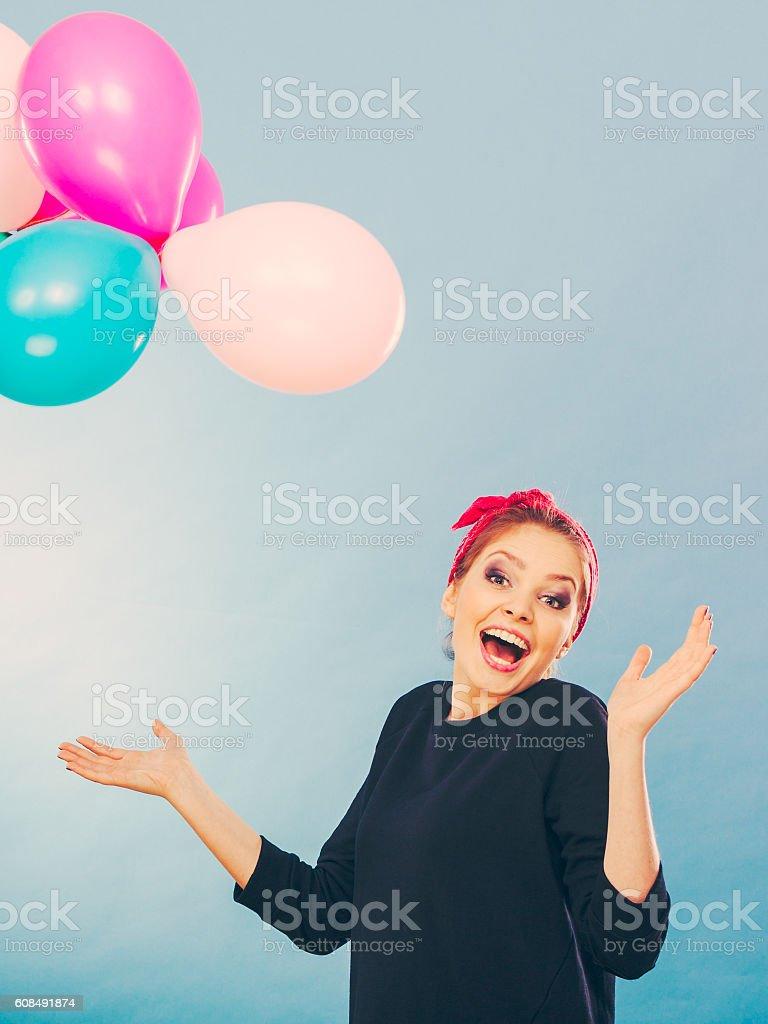 Smiling crazy girl having fun with balloons. stock photo