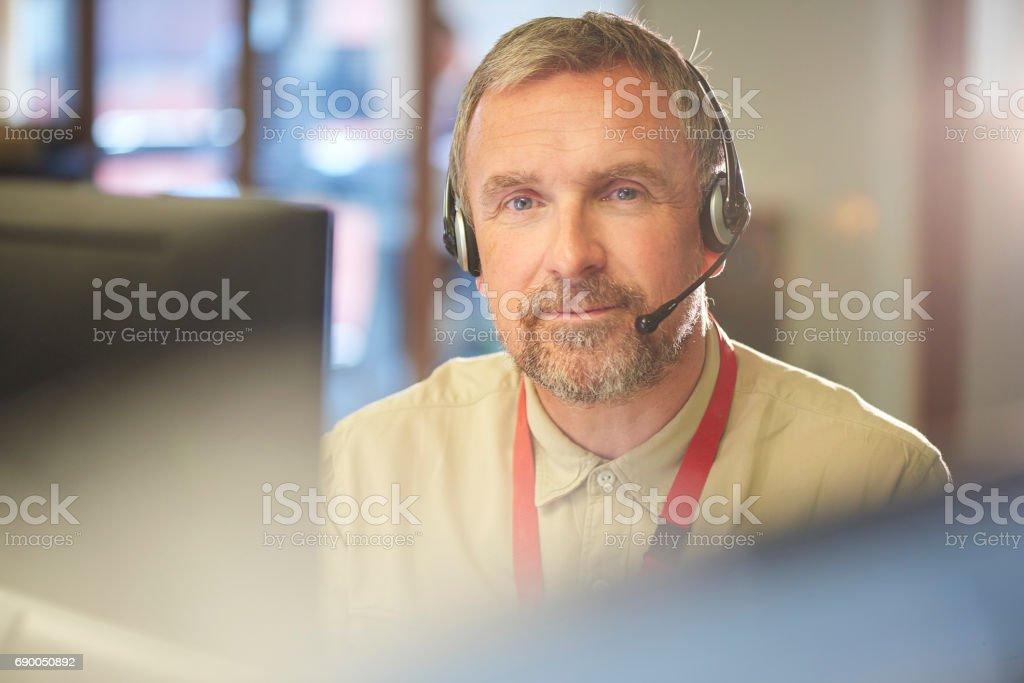 smiling customer service representative looking to camera stock photo