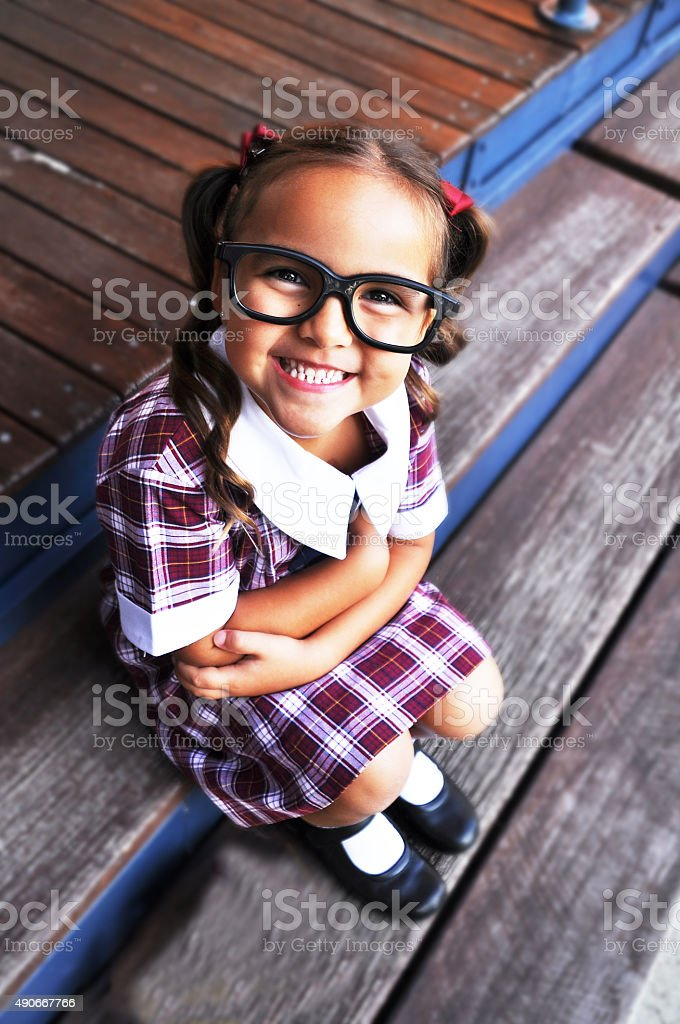 Smiling Cute Geeky girl stock photo
