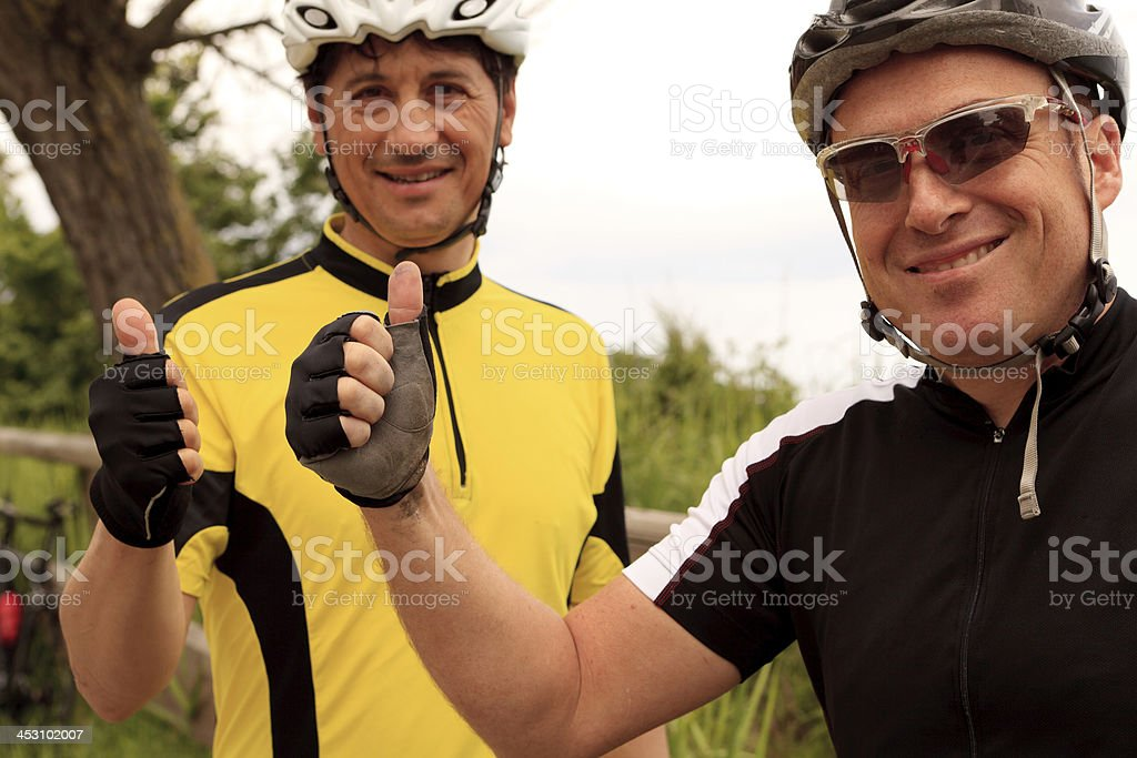 smiling cyclist with thumbs up royalty-free stock photo