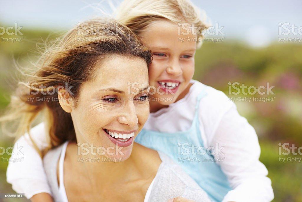 Smiling daughter getting piggyback ride royalty-free stock photo
