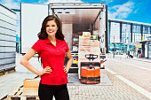 Smiling delivery person standing outdoors