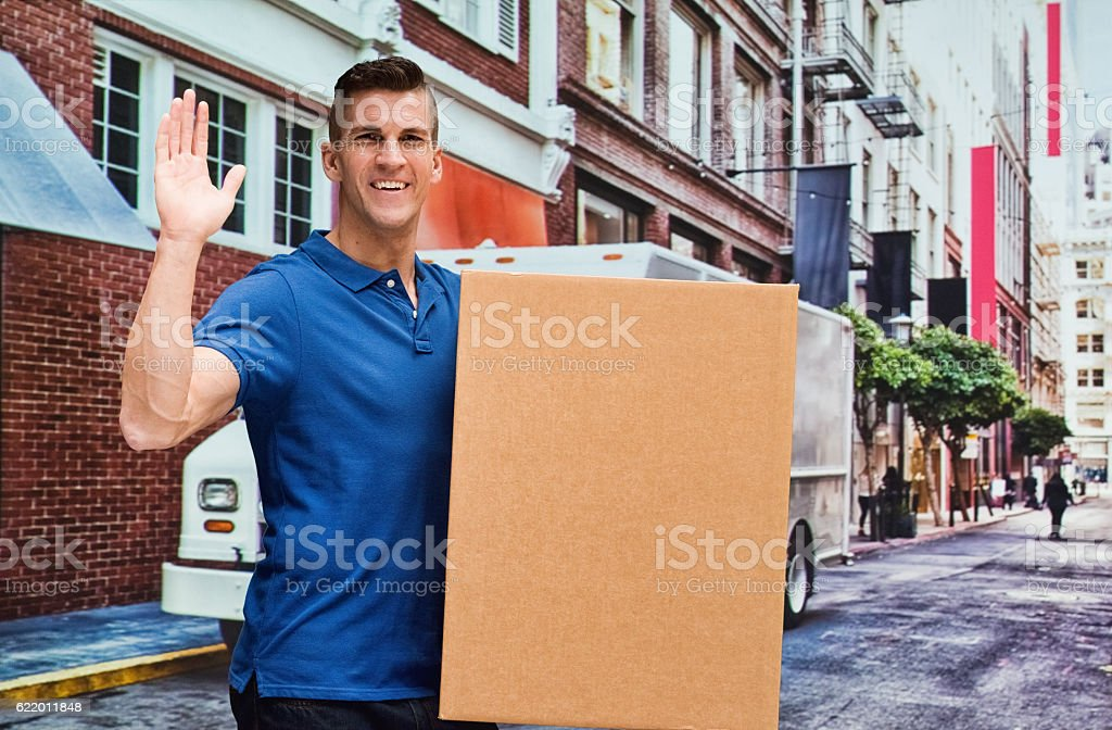 Smiling delivery person waving hand outdoors