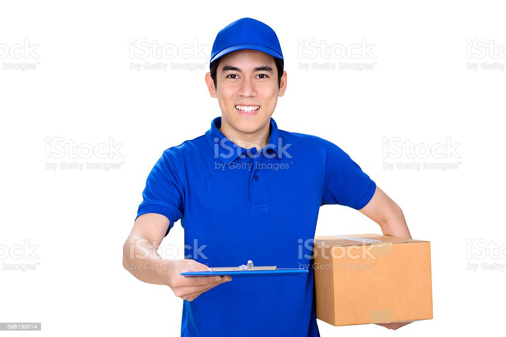 Smiling deliveryman giving clipboard stock photo