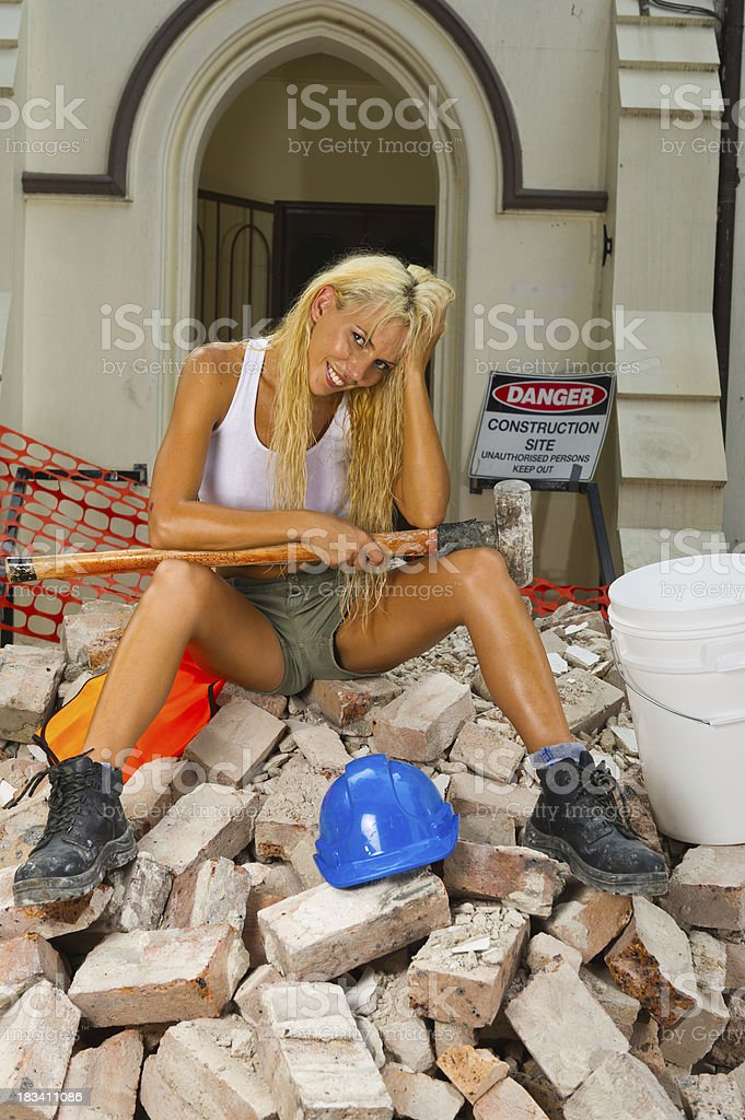 Smiling demolition Girl on construction site royalty-free stock photo