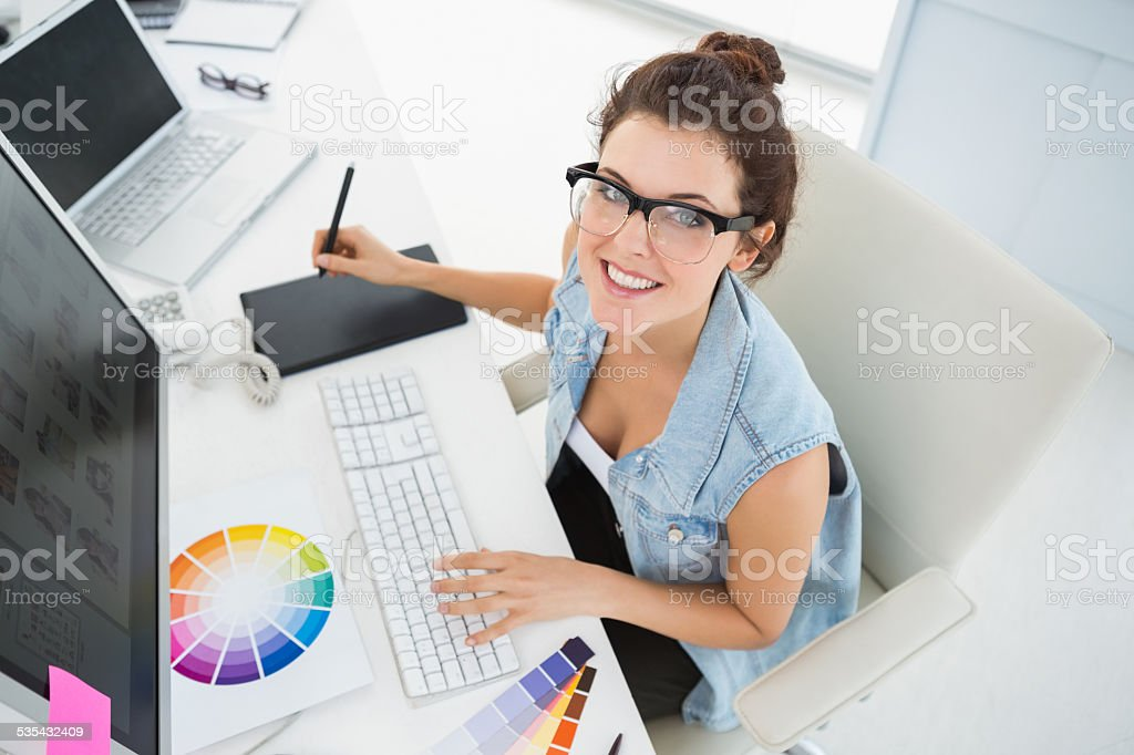 Smiling designer using computer and digitizer stock photo