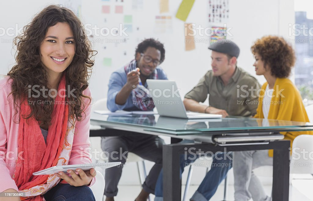 Smiling designer using tablet royalty-free stock photo