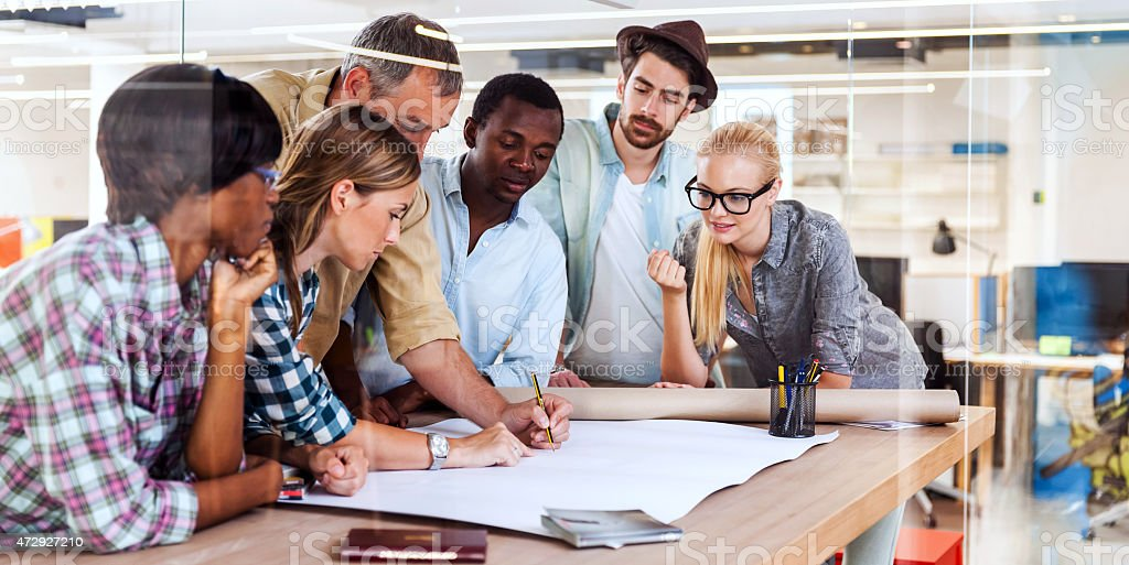 Smiling designers working together stock photo
