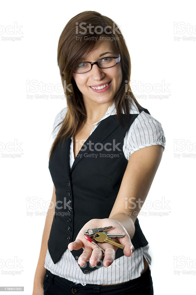Smiling developer gives keys to new home royalty-free stock photo