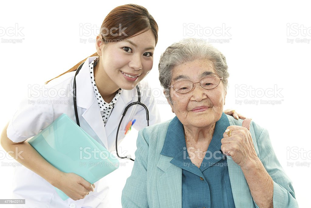 Smiling doctor and senior woman royalty-free stock photo