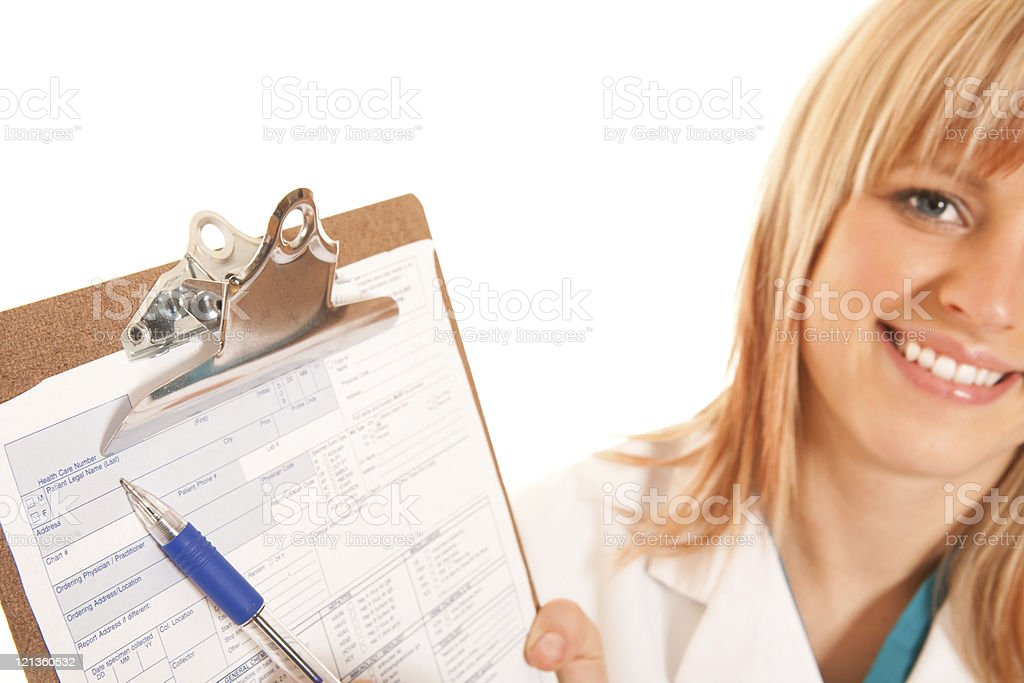 Smiling doctor holding a medical form royalty-free stock photo