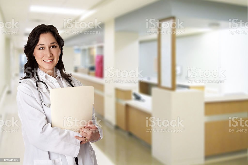Happy Doctor with patient chart file dossier in hospital stock photo