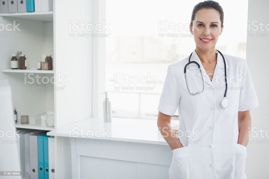 Smiling doctor looking at camera stock photo