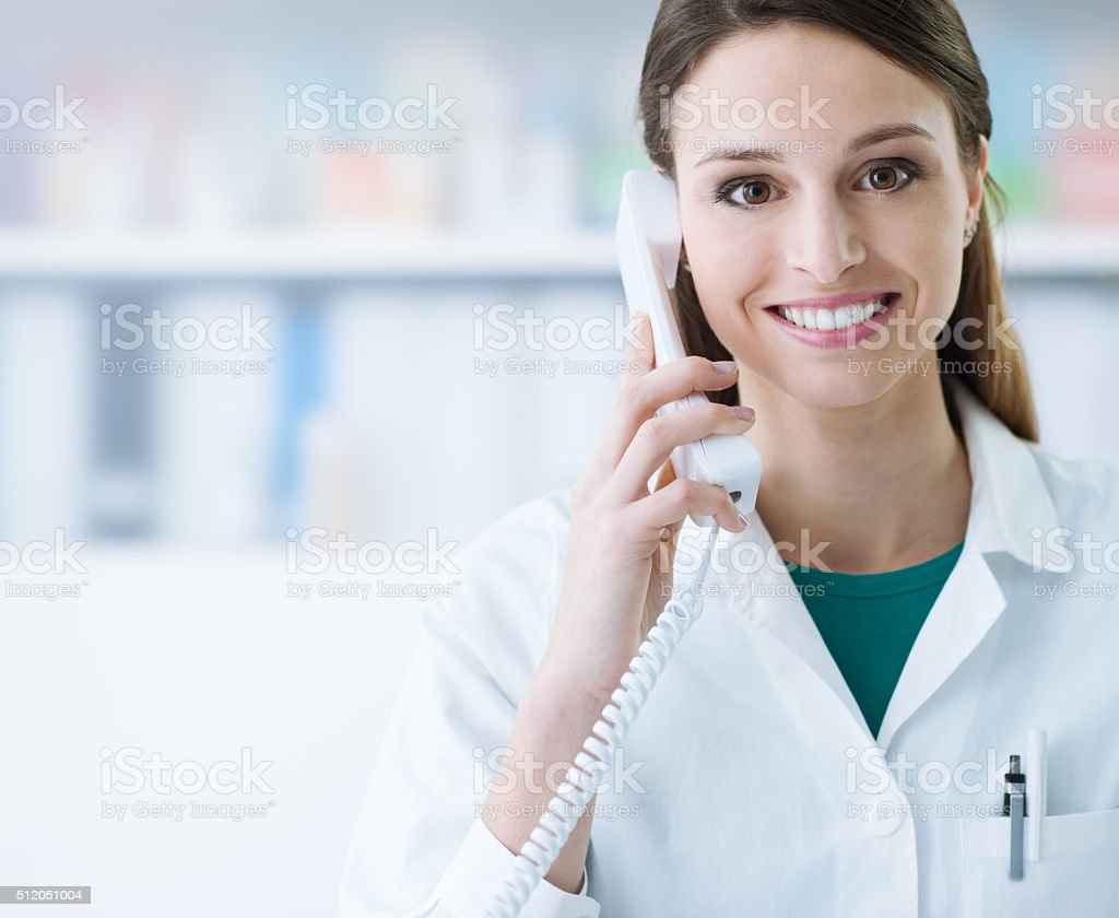 Smiling doctor phone calling stock photo