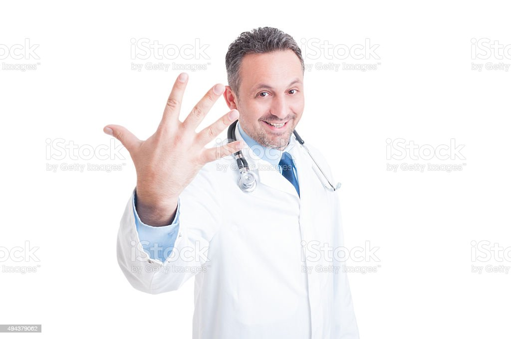Smiling doctor showing number five or fifth stock photo