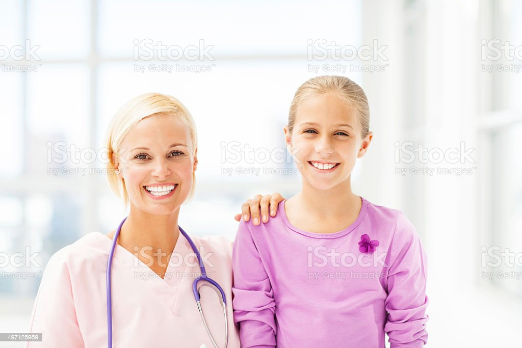 Smiling Doctor With Girl In Hospital royalty-free stock photo
