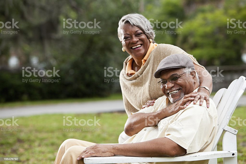 Smiling elderly African-American couple in park stock photo