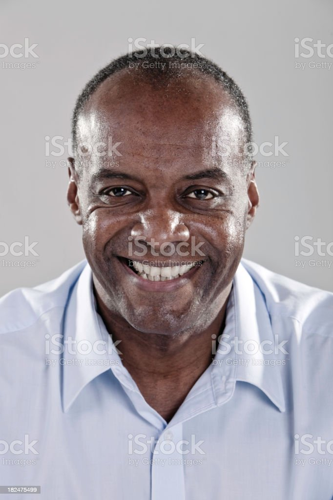 Smiling elderly man with shirt collar royalty-free stock photo