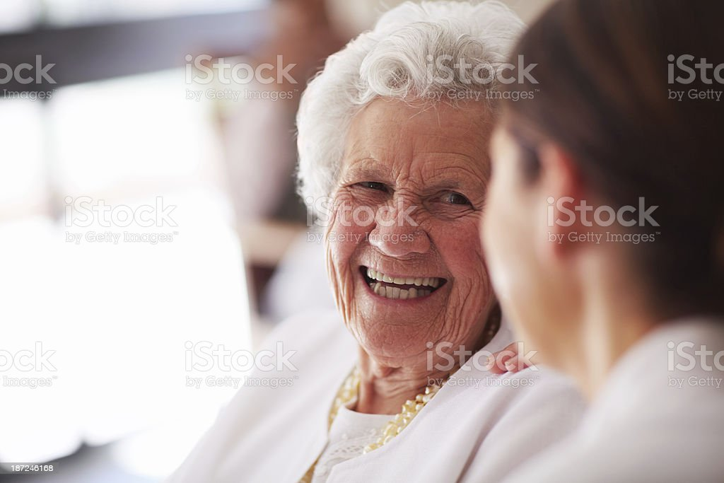 Smiling elderly woman and female nurse stock photo