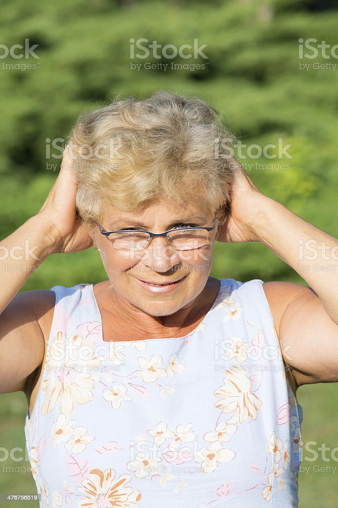Smiling elderly woman royalty-free stock photo