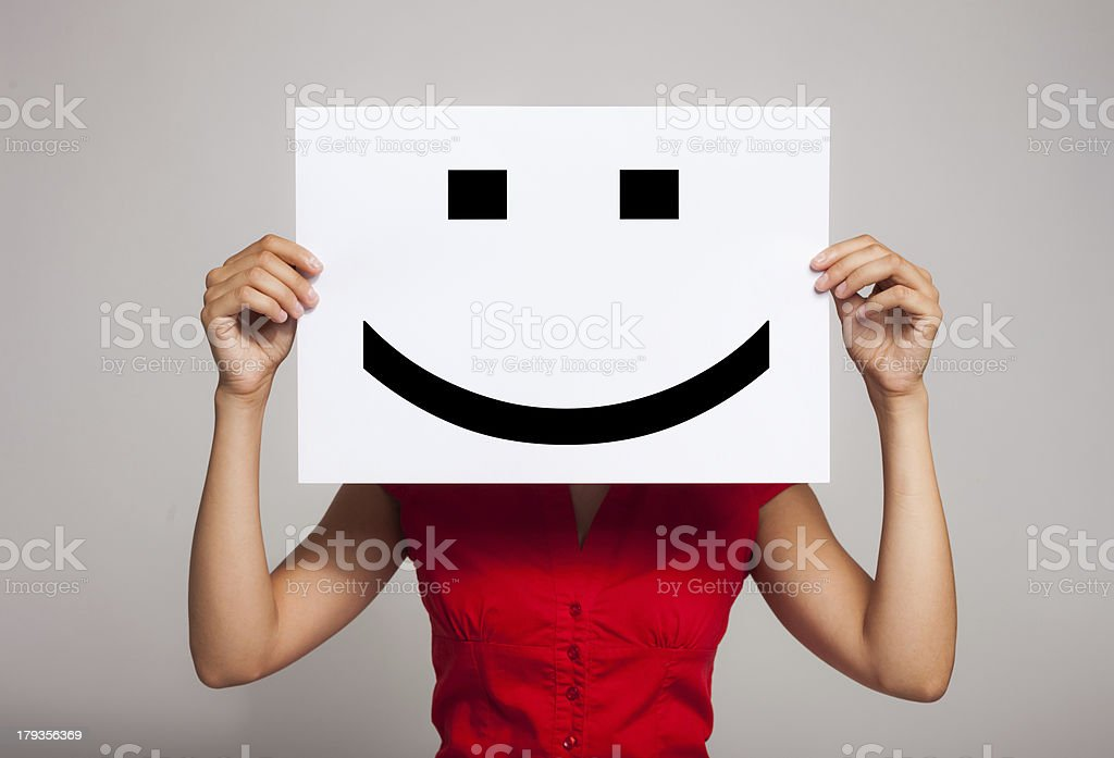 Smiling emoticon stock photo