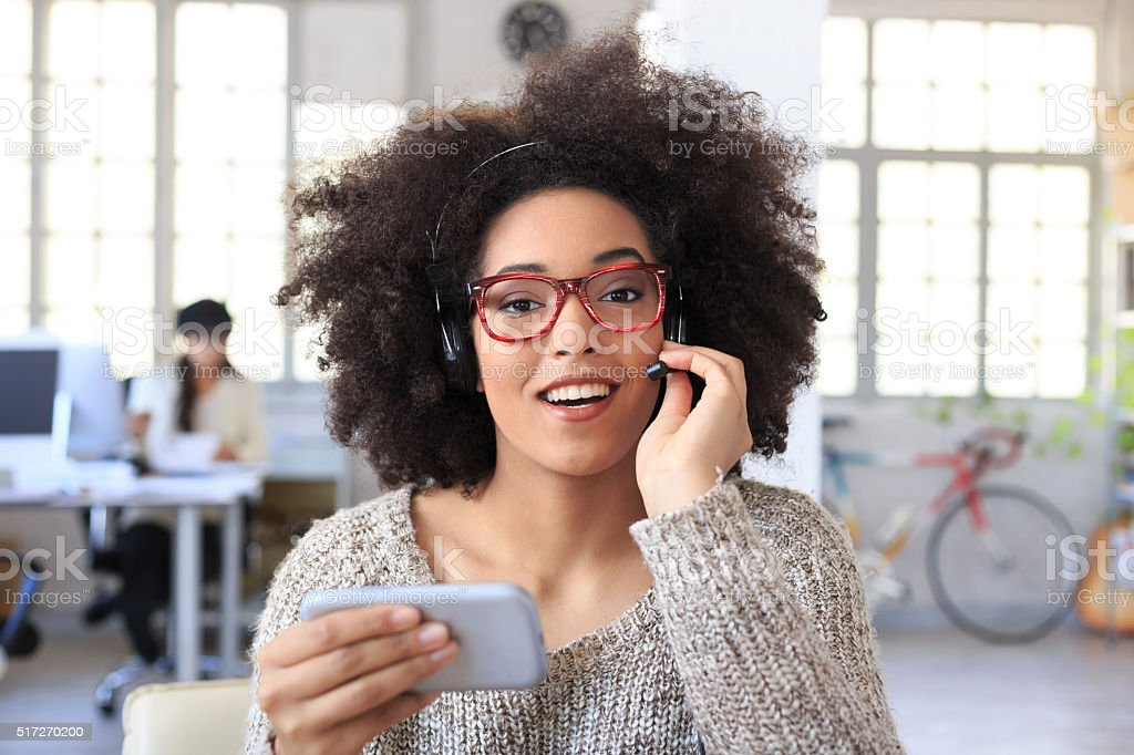 Smiling employee on telephone stock photo